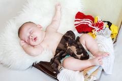 Baby sleeping in suitcase with clothes Royalty Free Stock Photography