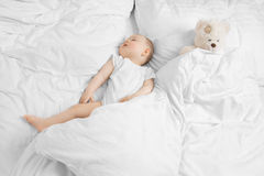 Baby sleeping with teddy bear Royalty Free Stock Photography