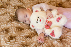 Baby sleeping with teddy bear Royalty Free Stock Images