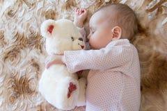 Baby sleeping with teddy bear Royalty Free Stock Photos