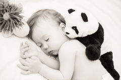 Baby sleeping with toys. royalty free stock photography