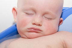 Baby Sleeping in Tub Stock Images