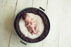 Baby sleeping in a tub Royalty Free Stock Photos