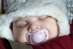 Baby sleeping after a walk Stock Image