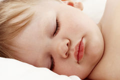 Baby sleeping in white bed Royalty Free Stock Photo