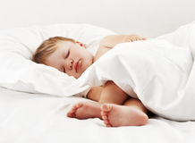 Baby sleeping in white bed stock photos