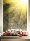 Baby sleeping on white blanket on window Royalty Free Stock Photography