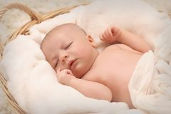 Baby Sleeping on White Cotton royalty free stock photography