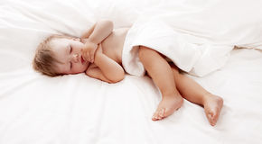Baby sleeping in white sheet Royalty Free Stock Photo