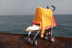 Baby sleeps on the beach royalty free stock photos