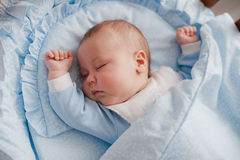 Baby sleeps with a cradle Stock Image