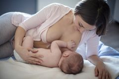 The baby sleeps easier with her mother`s milk stock image