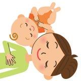 Baby sleeps with mom Stock Photos