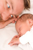 Baby sleeps next to his father Royalty Free Stock Images