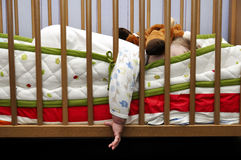 Baby sleeps put out hand for bed Royalty Free Stock Photography