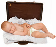 Baby sleeps in the suitcase Stock Photography