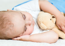 Baby sleeps under a blanket Royalty Free Stock Images