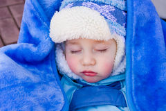 Baby sleeps on a walk Stock Photos