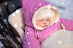 Baby sleeps during a walk in the park Stock Image