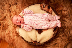 Baby sleeps on woolen pillow fell in childish bodysuit Royalty Free Stock Photo