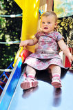 Baby on slide Stock Image