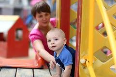 Baby on slide Stock Image