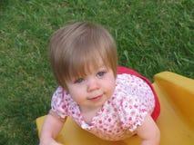 Baby on slide stock photo