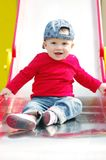 Baby on slide. Baby age of 10 months on slide Stock Images