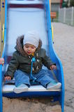 Baby on slide Royalty Free Stock Photography