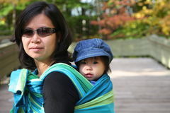 BABY IN SLING. Wearing baby in a sling Royalty Free Stock Photo