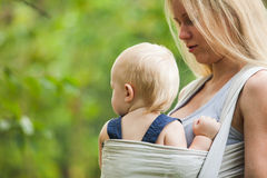Baby in sling Stock Photos