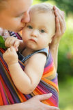 Baby in sling Stock Image