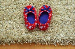 Baby slippers. Baby girl's shoes on the carpet Royalty Free Stock Images