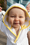 Baby in small bathrobe after swimming Royalty Free Stock Image