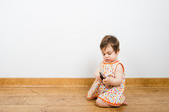 Baby with smart phone Stock Image
