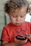 Baby on smartphone Royalty Free Stock Photography
