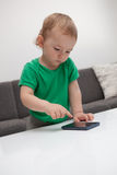 Baby with smartphone Royalty Free Stock Images