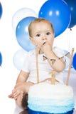 Baby smashing cake Stock Photo