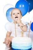 Baby smashing cake Royalty Free Stock Image