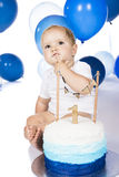 Baby smashing cake Royalty Free Stock Photo