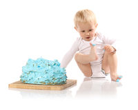 Baby smashing cake Royalty Free Stock Photos