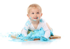 Baby smashing cake Stock Photo
