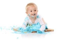 Baby smashing cake stock photography