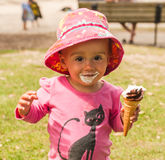 Baby smeared with ice cream Stock Photo