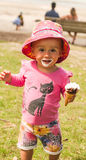 Baby smeared with ice cream Stock Images