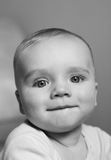 Baby smile. Baby boy looking into the camera smiling Royalty Free Stock Photography