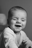 Baby smile. Baby boy interested with eyes closed smiling Royalty Free Stock Photography