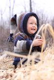 Baby smile. Baby laughing in a field during fall Royalty Free Stock Photos