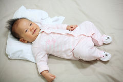 baby smile on the bed Stock Photos