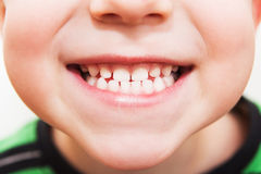 Baby smile close. With white teeth Royalty Free Stock Image